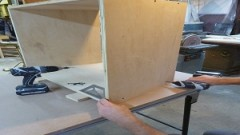 This is an image of a cabinet being assembled