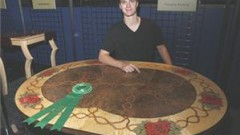 Fresh Wood competitor, Timothy Keating from Cedar Ridge High School, Chapel Hill, N.C., won The People's Choice Award for his Wandering Roses Table.