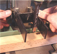 Set the hold-down on a mortiser