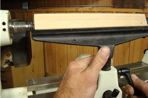 Set the height of the tool rest so it's slightly below the center axis of the spindle.