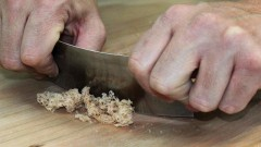 This is an image of someone scrapping wood