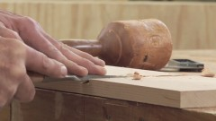 Using a chisel to cut a dado